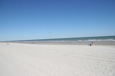 This is our beautiful very wide white sandy beach.
