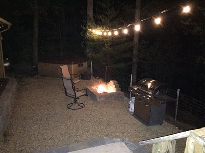 Rustic Charm lit patio with firepit hot tub and gas grill