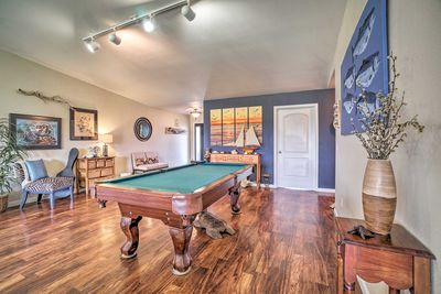 This vacation rental home boasts a pool table!