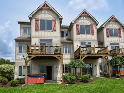 Photo for Stylish & Appealing 4 Bedroom townhome with lake & ski slope views!