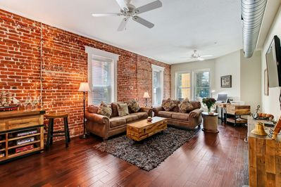 Gorgeous Exposed Brick - wood floors - cozy living space!