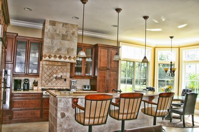 Open floor plan with kitchen opening to living and dining
