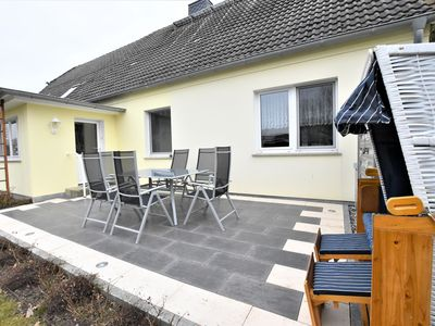Photo for Modern holiday home with terrace and beach chair near the beach