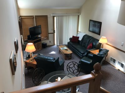 Great room has two leather recliners and pull out sofa bed
