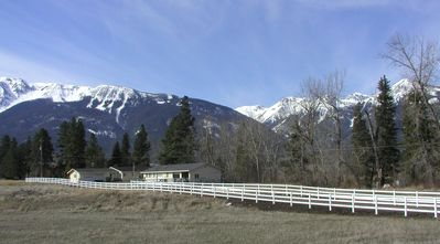 Cowboy Riverfront Retreat surrounded by the Wallowa Mountains