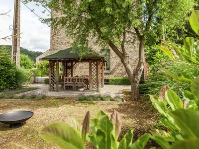 Photo for Authentic village house with romantic garden and wooden gazebo.