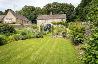 Photo for Old Farm Cottage is a stunning Cotswold stone cottage, which sits in beautiful, large gardens