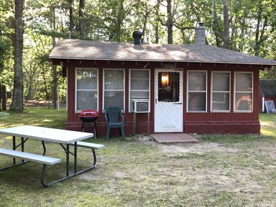 """Cozy """"Up North"""" Cabin in the woods with Pentwater Lake frontage and access"""