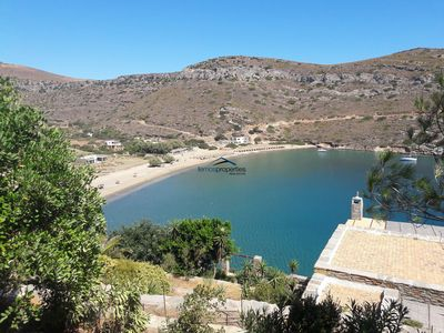 Photo for Stone built waterfront villa with direct access to the sandy beach of Spathi,