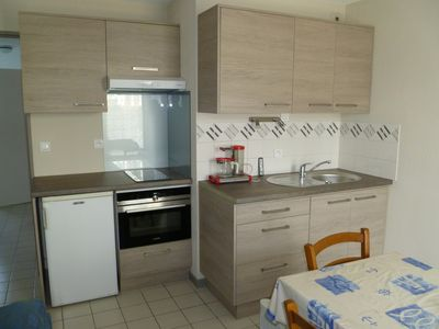 Photo for Flat in ground level residence with pool et private car park, 300 m from beach