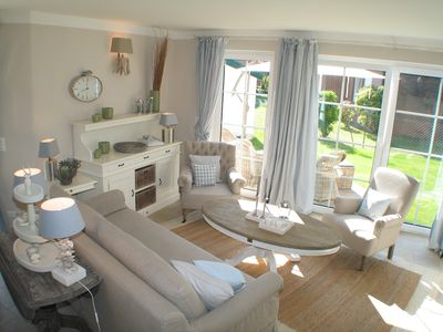 Photo for Exclusive apartment with garden and fireplace near the beach