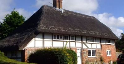 Photo for Heritage Thatched Cottage