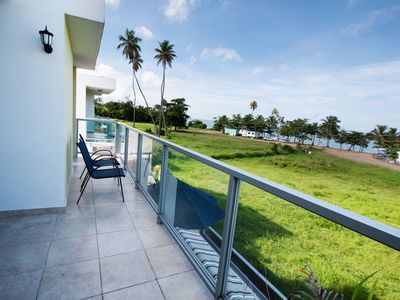 Photo for Beachfront in gated community with patio,  balcony, pool, close to all in Rincón