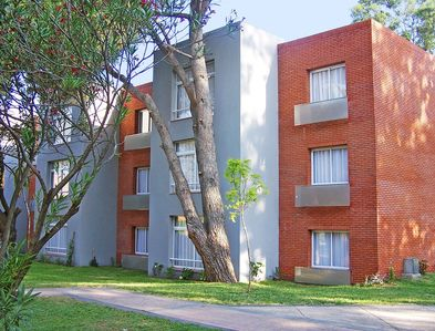 A scenic pathway of the multi story condos.