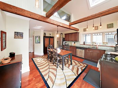Kitchen - Grand vaulted ceilings display exposed beams and a stunning stained glass window in the kitchen.