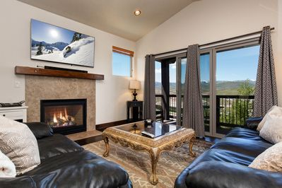 """Living Room - Couches face a gas fireplace with a 40"""" TV in the living room"""