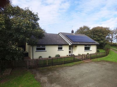 Photo for Tucked away behind some trees next to a working Pembrokeshire dairy farm, this single-storey, spacio