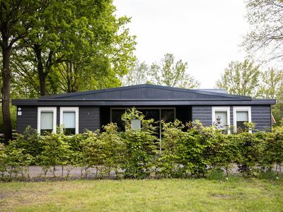 "Photo for Spacious holiday bungalow ""Roy"" in wooded and quiet area (12 p)"