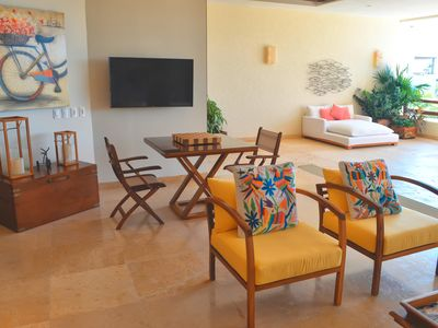 Photo for Vacation is here ! Elegant beach front condo , common pools , luxury layout,