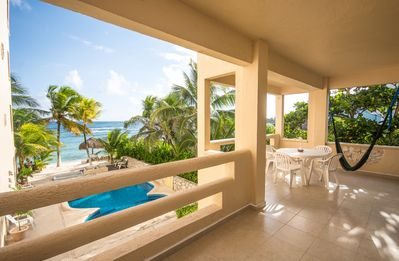 Photo for Fabulous beachfront condo with pool and onsite restaurant