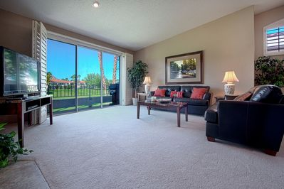 Living Room with HGTV and view of golf course and mountains