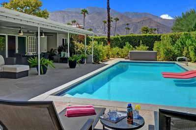 Master bedroom patio with chaise lounges that face over the pool and spa to the Western mountain view.