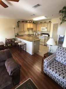 View of Kitchen with Granite Counter tops from Living Area