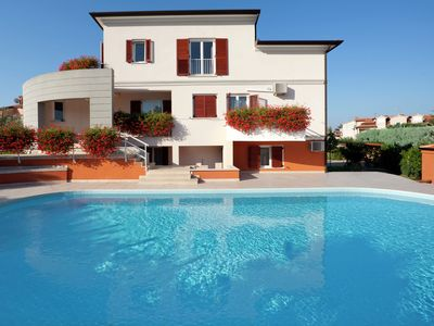 Photo for Modern equiped three bedroom apartment with balcony and  shared pool, near Porec