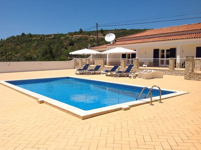 Patio area & swimming pool, accessible from four rooms in the villa.