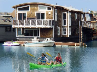 Kayaking from rear dock of floating home.