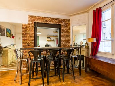 Photo for Warm & stylish 1BR apartment in the 17th, 4 mins from metro, sleeps 4 (Veeve)