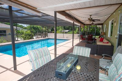 Large pool with beautiful lanai seating, firepit, grill and plenty of seating
