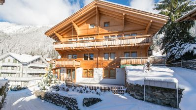 Photo for Stylish and Trendy ski-in, ski-out 2-bedroom apartment in Chalet Sole!