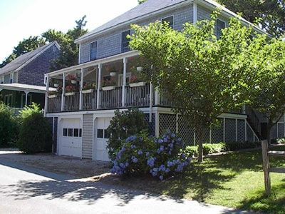 Photo for North Falmouth 6 br house with huge porch 2 block walk to public beach