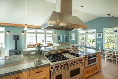 The kitchen offers all desired cookware, double oven, and gourmet gas range.