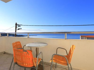 Photo for Three bedroom apartment with terrace and sea view Mali Rat, Omiš (A-7482-b)
