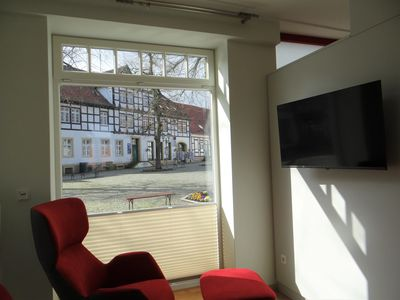 Photo for Modern apartment with a fireplace in a listed half-timbered house on the market square