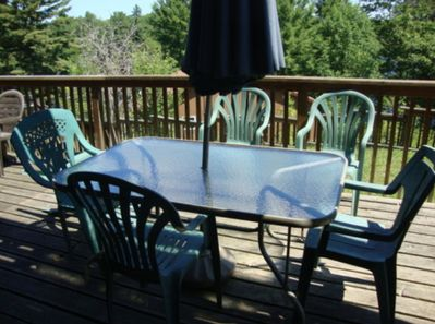 Deck with view of lake Patio set and BBQ behind photographer
