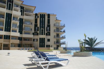 The pool area at Vila Formosa, sunbeds included