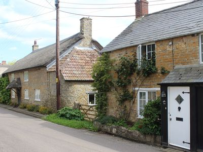 Photo for A charming stone fronted 2 bedroom cottage with delightful south facing garden
