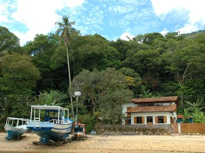 Photo for Beautiful three bedroom, fisherman's house style villa at the foot of the sand of Abraão beach