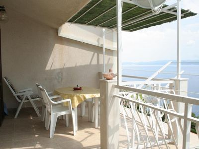 Photo for Two bedroom apartment with terrace and sea view Stanići, Omiš (A-1028-b)