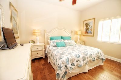 Open and airy master bedroom with king bed and attached bath.