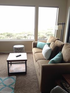 Photo for Magnificent Ocean front condo!  Just steps from the beach! Sleeps 5-6.