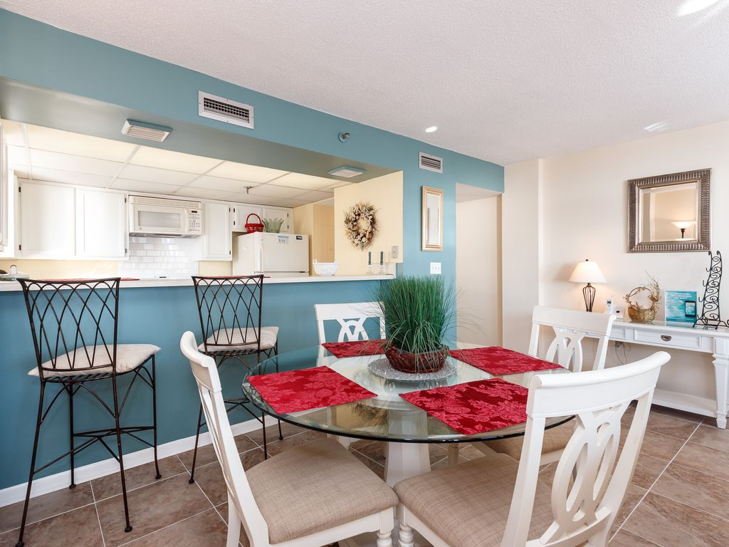 GS 203:WRAP AROUND BALCONY, GORGEOUS UPGRADES INCLUDE FLOORING AND FURNITURE!
