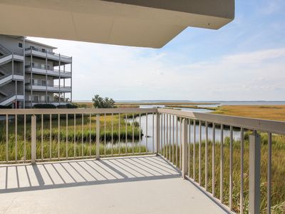 Photo for Bayfront views, a shared hot tub & pool, just steps away to beach!