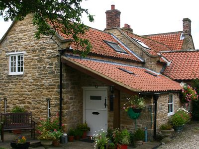 Photo for Delightful stone cottage with indoor heated swimming pool, gardens and games roo