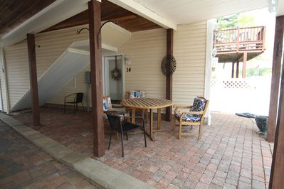 Private covered patio includes grill for outdoor cooking.