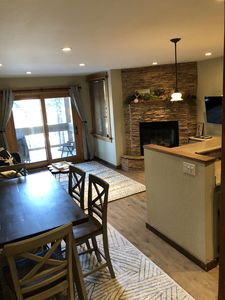 New flooring and furniture in the living / dining / kitchen spaces
