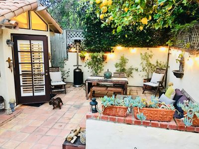 Front courtyard with patio heater and gas firepit